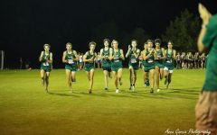 The Varsity Tigers clap-out before their racing debut at Run for the Gold.